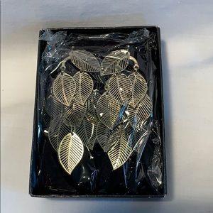 New old stock Avon earrings textured leaves